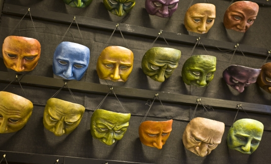 A wall of theatre masks