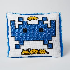Cushion with space invader embroidery