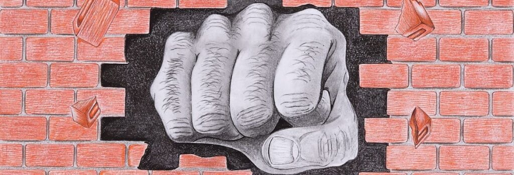 Drawing of a giant fist punching through a brick wall